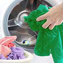 Place the pod in the machine before your clothes.  Avoid touching the capsules with your hands
